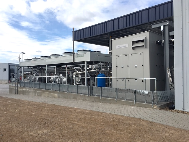 A Housed, Subcritical CO2 Package Operating Alongside a low-charge ammonia chiller